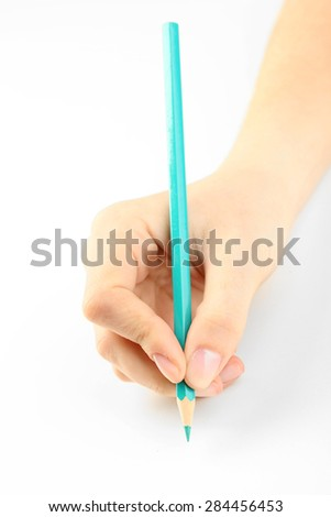 Female hand with colorful pencil isolated on white - stock photo