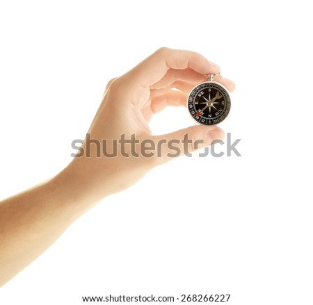 Female hand with compass - stock photo