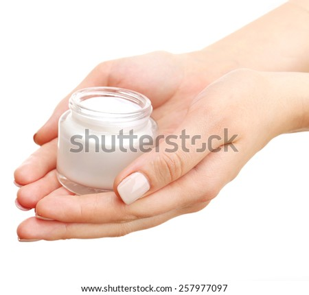 Female hand with cream isolated on white - stock photo