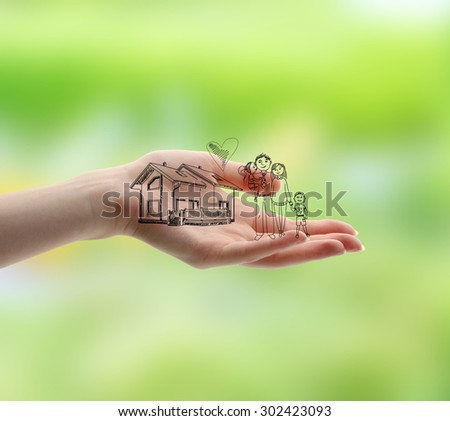 Female hand with drawings on nature background - stock photo