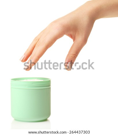 Female hand with jar of cream isolated on white - stock photo