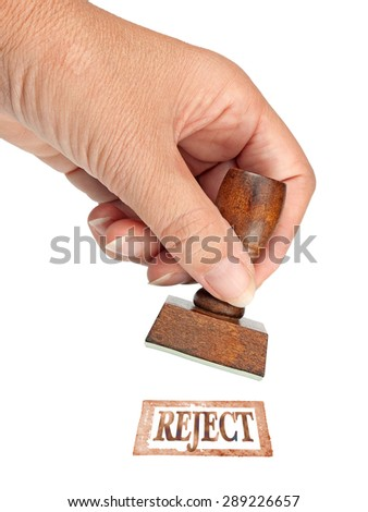 Female hand with rubber stamp, reject. Business deal etc. Isolated on white. - stock photo