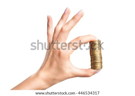 Female hand with stack of golden coins as hand OK sign isolated on white background - stock photo
