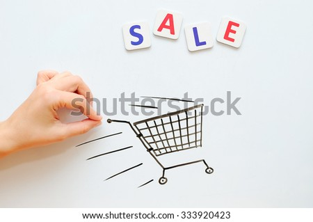 Female hand with the trade cart on sale - stock photo