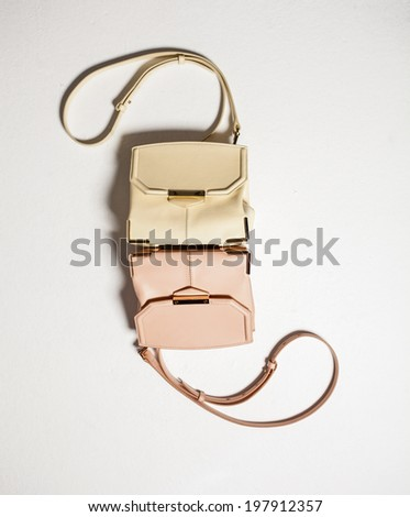 Female handbag isolated on white - stock photo