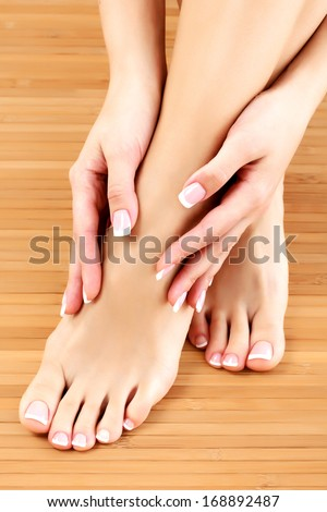 Female hands and feet  - stock photo
