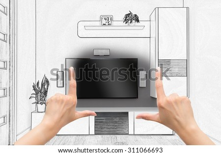 Female hands framing custom room design. Combination drawing and photo. - stock photo