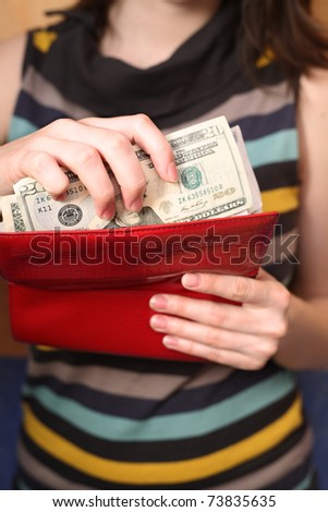 Female hands get money from a purse - stock photo