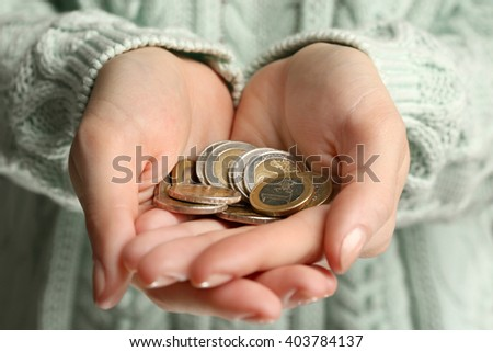 Female hands holding a handful of euro coins, close up - stock photo