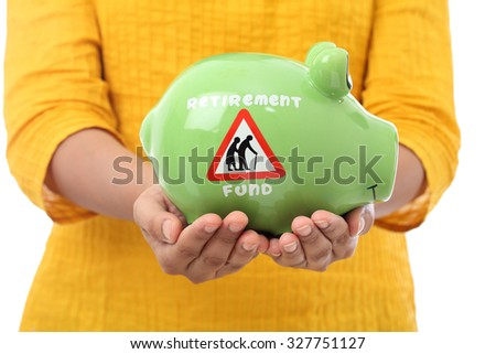 Female hands holding a piggy bank - stock photo