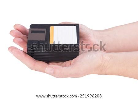 Female hands holding floppy disks on white background - stock photo