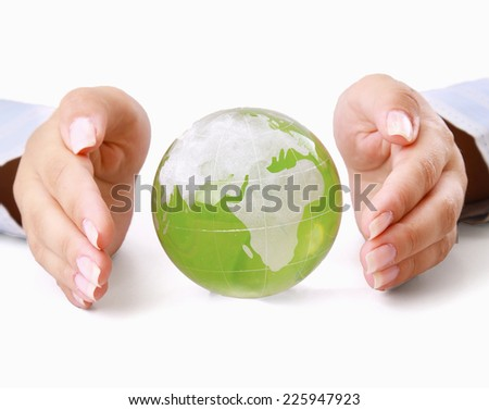 Female hands holding glass earth , isolated on white background. - stock photo