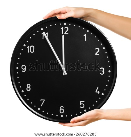 Female hands keeping clock isolated on a white background. Time concept - stock photo