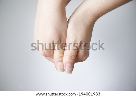 Female hands on a gray background. Copy space - stock photo