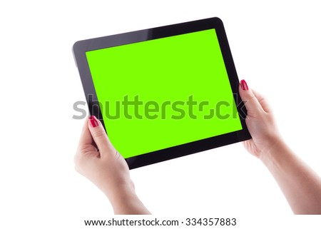 female hands on a white background holding tablet picture with depth of field, selective focus on the tablet. - stock photo