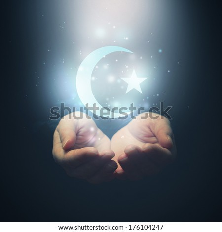 Female hands opening to light and half moon and star, symbol of islam religion - stock photo