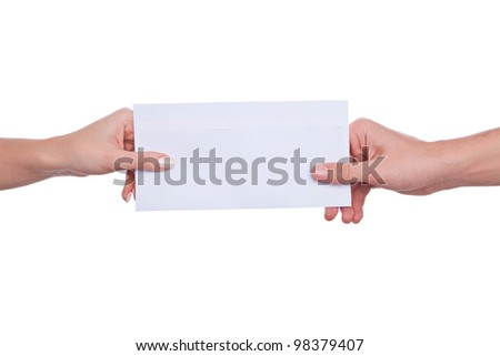 female hands passing exchange letter in envelope. isolated on white - stock photo