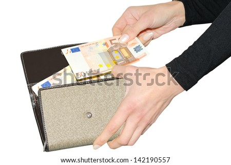 Female hands pulls out fifty euro banknote from purse isolated - stock photo