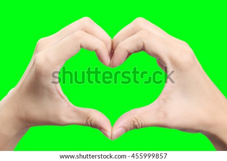 Female hands shaping a heart symbol on green screen - stock photo