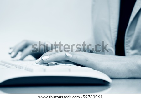 Female hands typing on keyboard. - stock photo