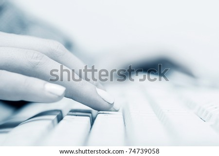 Female hands typing on the computer keyboard - stock photo