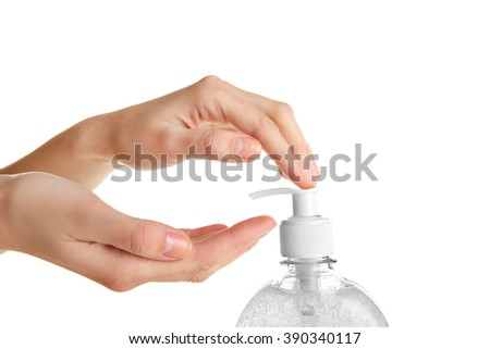 Female hands using liquid soap isolated on white - stock photo
