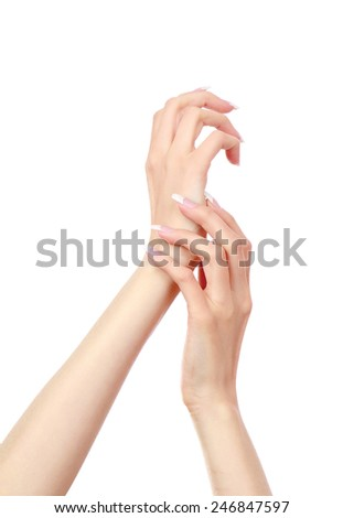 Female hands with a nice manicure - stock photo