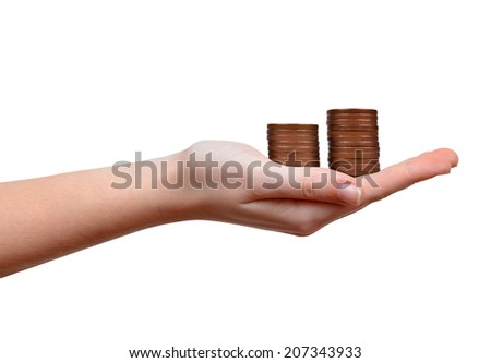 Female hands with coins over white background - stock photo