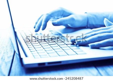 Female hands with credit card during shopping through Internet  - stock photo