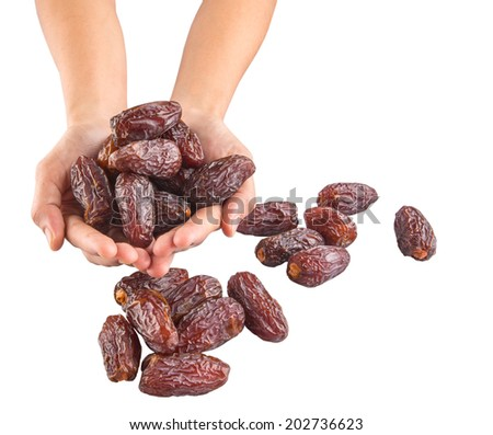 Female hands with date fruits over white background - stock photo