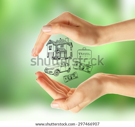 Female hands with drawings on nature background - stock photo