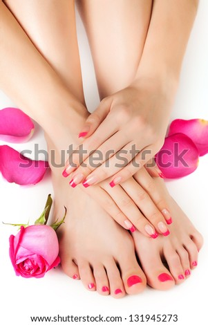 female hands with fragrant rose petals and towel - stock photo