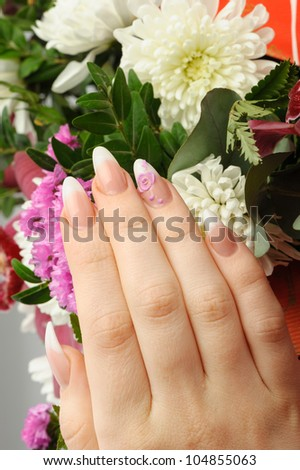 Female hands with manicure closeup. Against an flower - stock photo