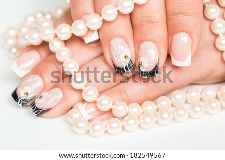 Female hands with manicure closeup on light background - stock photo