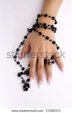 female hands with pearls - stock photo