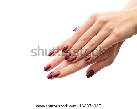 Female hands with perfect manicure over white isolated background - stock photo