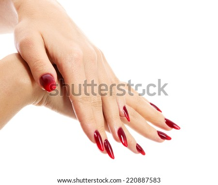Female hands with red fingernails, white background, isolated  - stock photo