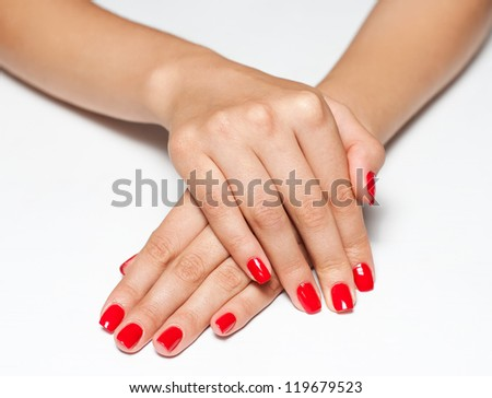 Female hands with red manicure - stock photo