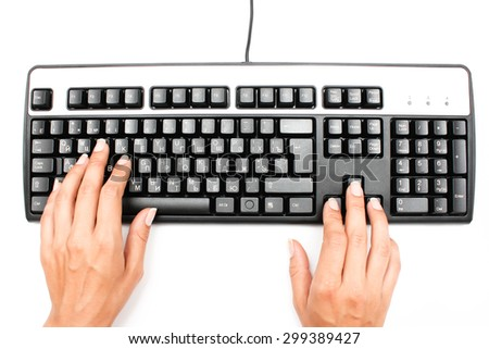 Female hands working on the keyboard - stock photo