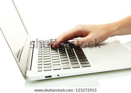 female hands writing on laptot, isolated on white - stock photo