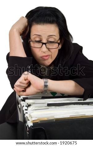 Female hanging over file crate looking at watch - stock photo