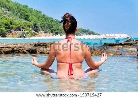 Female have meditation time on the beach. Selective focus on the female - stock photo