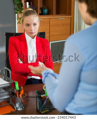 Female having difficult conversation with employee - stock photo