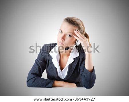 Female helpdesk operator on white - stock photo