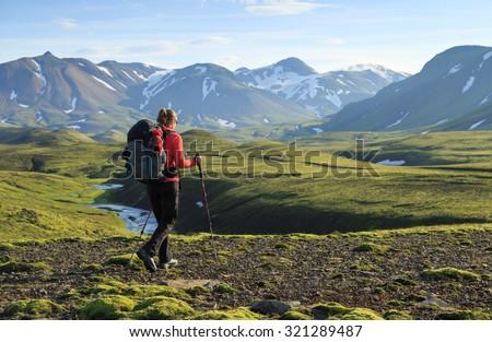 Female hiker enjoying the landscape of Iceland while hiking the Laugavegur trail. - stock photo