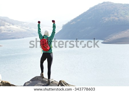Female hiker proud of her accomplishments - stock photo
