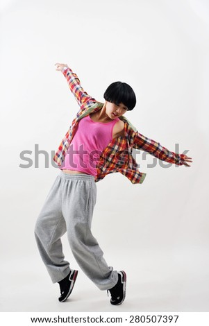 Female hip hop dancer in motion. Studio white background - stock photo
