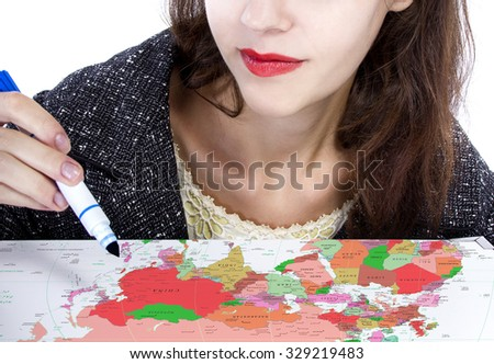 Female holding a pen and writing on a map for travel plans.  The composition is a close up on a generic map with no logos. - stock photo