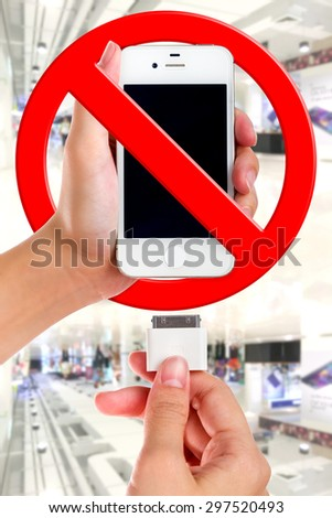 Female holding USB port charger wrong connect to smart phone. - stock photo
