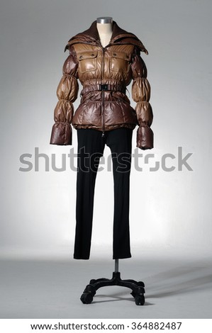 female in jacket on mannequin - stock photo